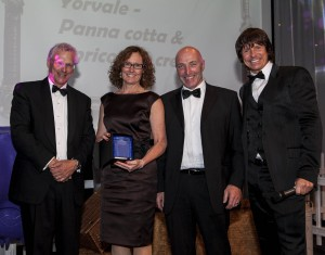Lesley and Ian Buxton (pictured centre) collect their award at The Cream Awards